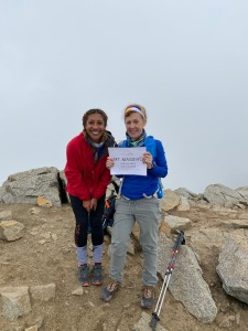 At the top of Mt. Massive with my mom and our Team Brooks sign.